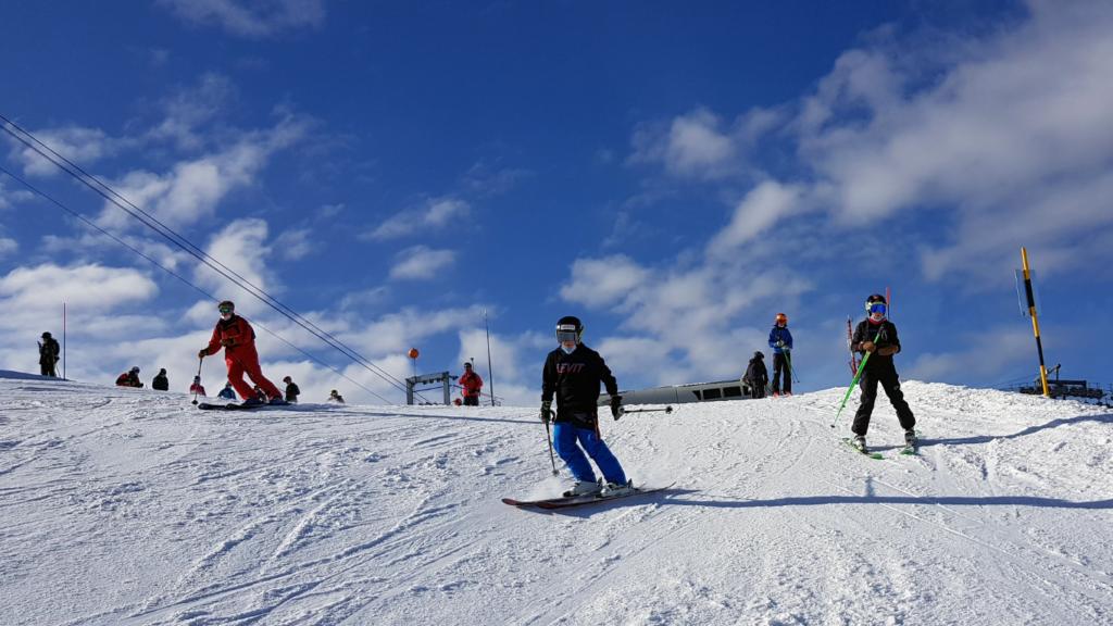 Skiers on Lac des Vaux run off Attelas, Verbier