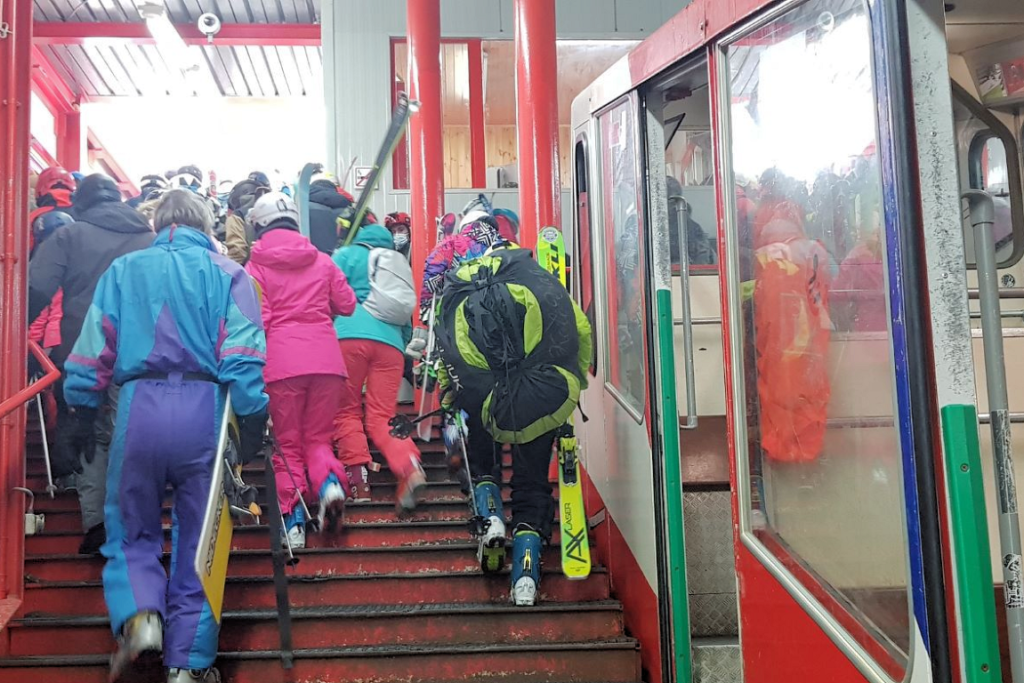 Skiers and snowboarders exit the undeground train at Allalin.